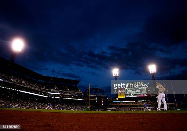 Rob Zastryzny of the Chicago Cubs pitches in the first inning under ominous skies during the game against the Pittsburgh Pirates at PNC Park on...
