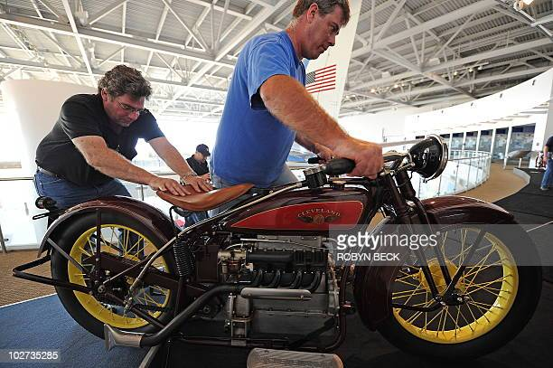 Rob Zucca and Chris Coulter wheel in a 1928 Cleveland for installation in the 'Born to be Wild Vintage and Celebrity Motorcycles' special exhibit in...