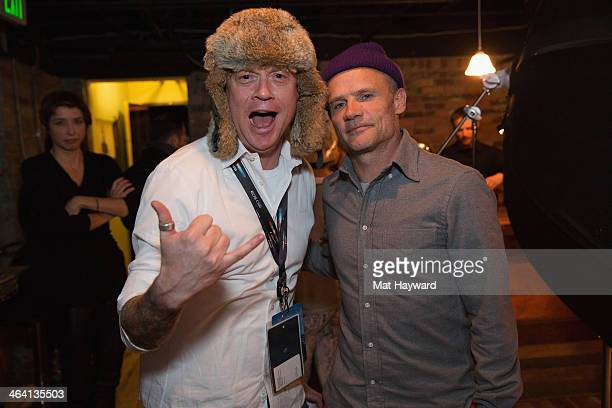 Rob Zuurbier and Flea pose for a photo at the Canon Craft Services Lounge during the Sundance Film Festival on January 20 2014 in Park City Utah