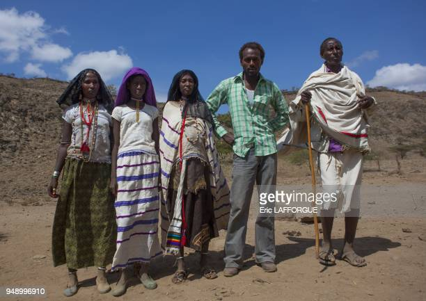 Roba bulga and his karrayyu family dressed in traditionnal and modern clothes down a rocky hill metahara Ethiopia on January 10 2012 in Metehara...
