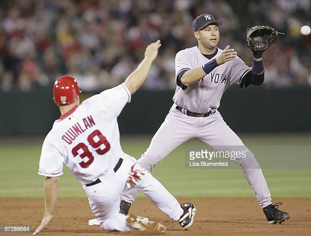 Robb Quinlan of the Los Angeles Angels of Anaheim is forced out at second base ob a double play by Derek Jeter of the New York Yankees in the third...