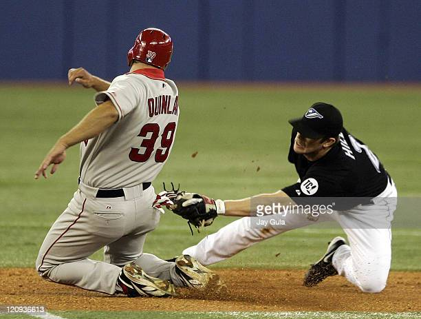 Robb Quinlan of the Los Angeles Angels of Anaheim is tagged out by Toronto Blue Jay 2nd baseman Aaron Hill at Rogers Centre in Toronto Canada on May...