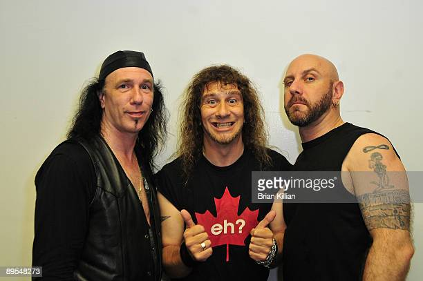 Robb Reiner Steve Kudlow and Glenn Five of the rock group Anvil backstage at Giants Stadium on July 31 2009 in East Rutherford New Jersey