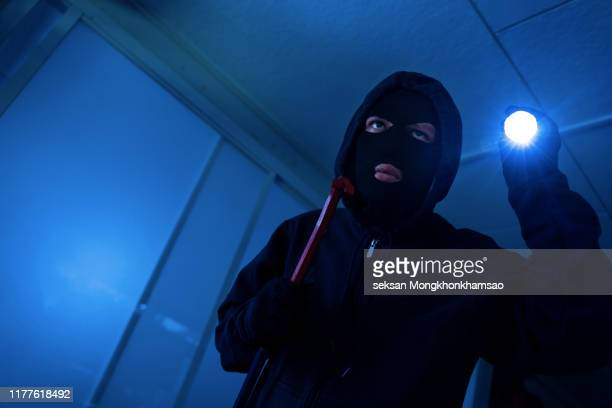 robber breaks house - burglar stock pictures, royalty-free photos & images