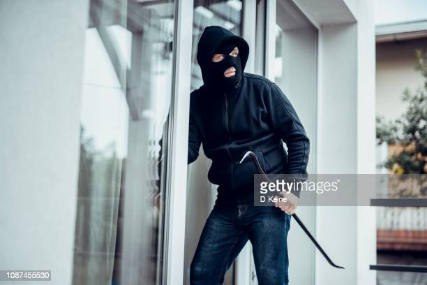 robber - burglar stock pictures, royalty-free photos & images