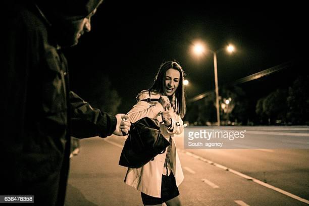 Robber stealing businesswoman purse