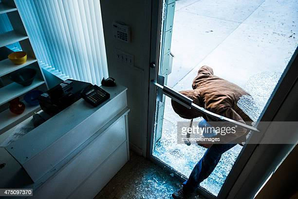robber using a sledgehammer, - burglar stock pictures, royalty-free photos & images