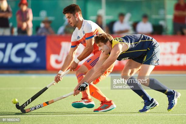 Robbert Kemperman of Holland competes with Eddie Ockenden of the Kookaburras during game one of the International Test Match series between the...