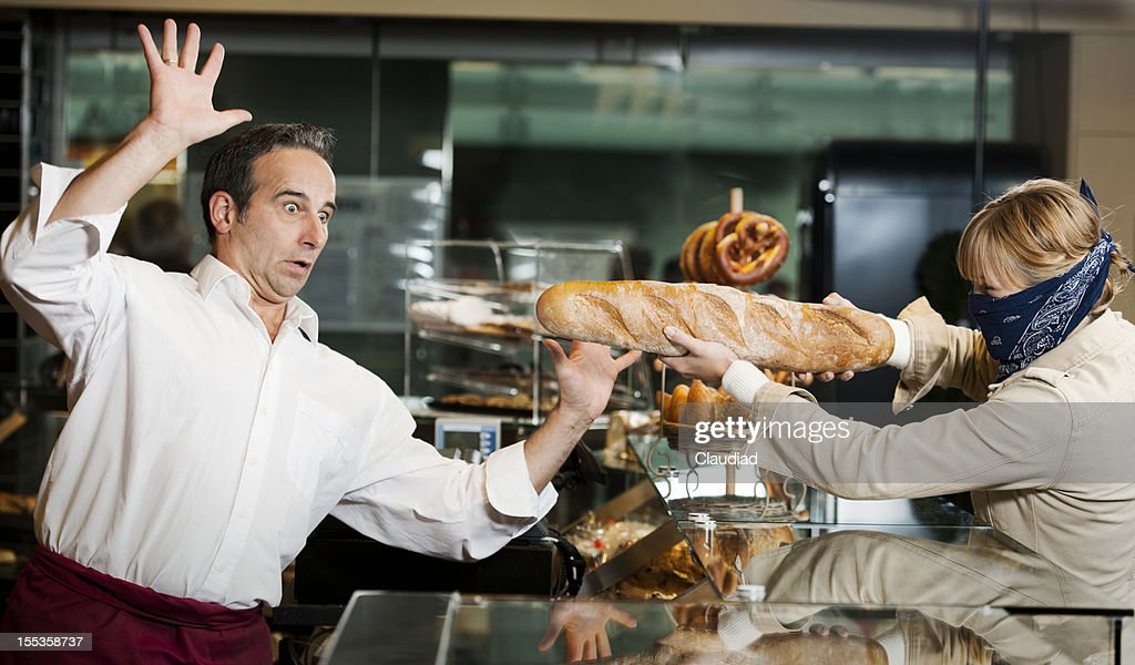 Robbery in bakery : Stock Photo
