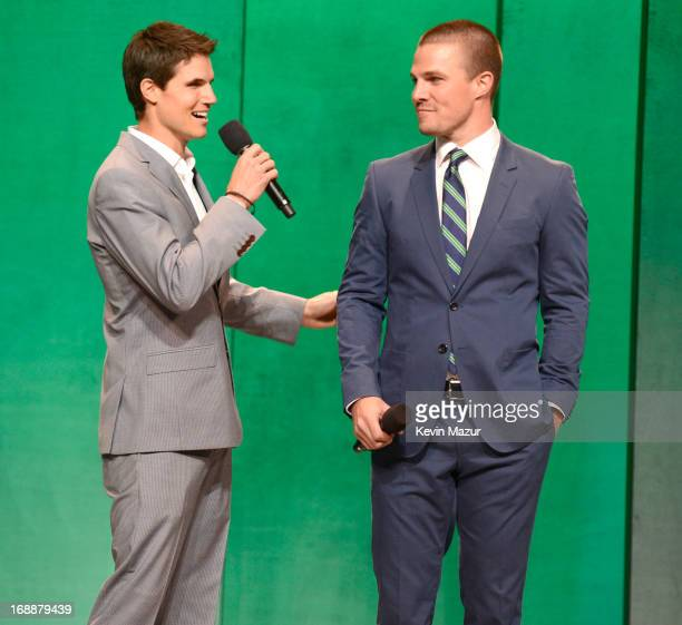 Robbie Amell and Stephen Amell speak on stage at the CW Network's 2013 Upfront at New York City Center on May 16 2013 in New York City