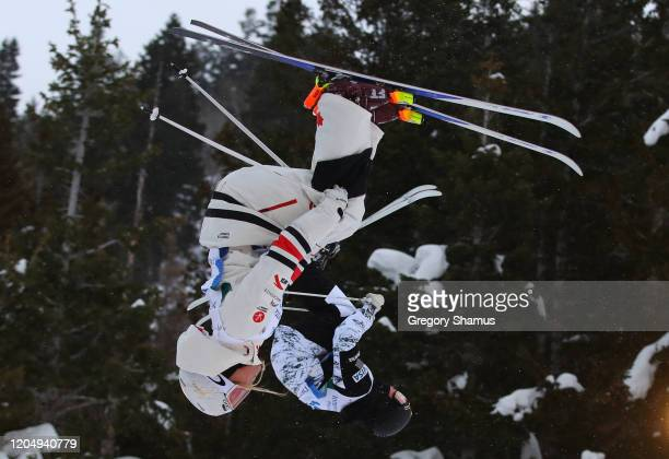 Robbie Andison of Canada competes against Dylan Walczyk of the United States during the Men's Dual Moguls at the FIS Freestyle Ski World Cup at Deer...