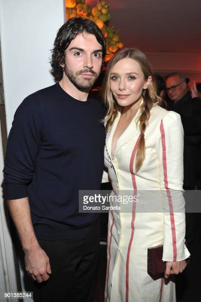 Robbie Arnett and Elizabeth Olsen attend W Magazine's Celebration of its 'Best Performances' Portfolio and the Golden Globes with Audi Dior and Dom...