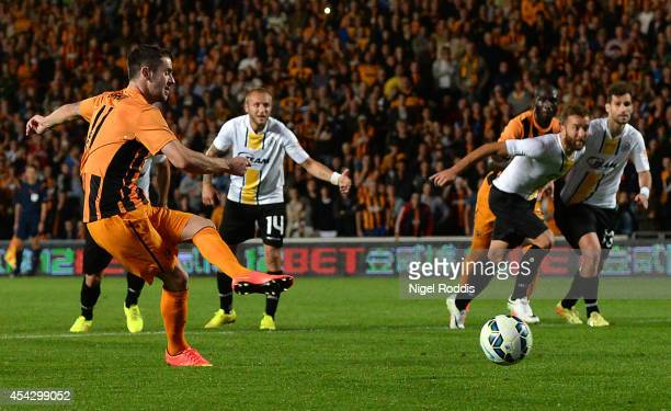 Robbie Braddie of Hull City shoots to score a penalty against KSC Lokeren during the Hull City v KSC Lokeren UEFA Europa League Qualifying PlayOffs...