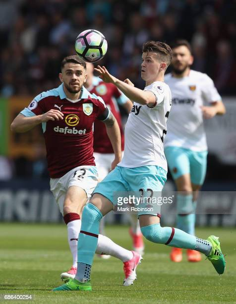 Robbie Brady of Burnley and Sam Byram of West Ham United watch the ball during the Premier League match between Burnley and West Ham United at Turf...