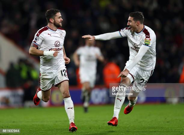 Robbie Brady of Burnley celebrates after scoring his sides second goal with Stephen Ward of Burnley during the Premier League match between AFC...