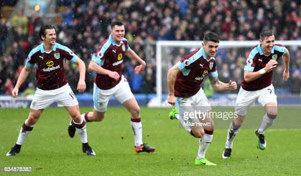Robbie Brady of Burnley celebrates scoring his sides first goal with team mates during the Premier League match between Burnley and Chelsea at Turf...