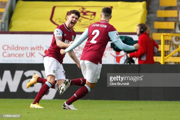 Robbie Brady of Burnley celebrates with teammate Matthew Lowton after scoring his team's first goal during the Premier League match between Burnley...