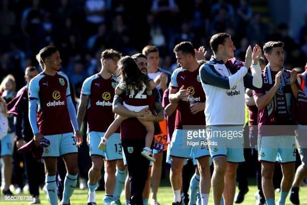 Robbie Brady of Burnley enjoys the lap of honour with his child after the Premier League match between Burnley and AFC Bournemouth at Turf Moor on...