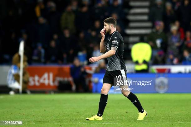 Robbie Brady of Burnley leaves the pitch after being shown a red card during the Premier League match between Huddersfield Town and Burnley FC at...