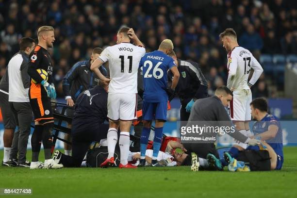Robbie Brady of Burnley receives treatment from the medical team during the Premier League match between Leicester City and Burnley at The King Power...
