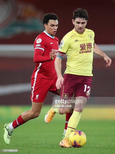 Robbie Brady of Burnley runs with the ball whilst under pressure from Trent Alexander-Arnold of Liverpool during the Premier League match between...