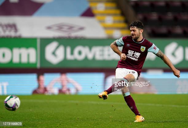 Robbie Brady of Burnley scores the winning penalty in the shoot out during the Carabao Cup second round match between Burnley and Sheffield United at...