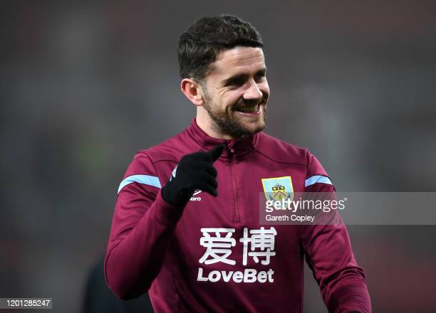 Robbie Brady of Burnley warms up prior to the Premier League match between Manchester United and Burnley FC at Old Trafford on January 22 2020 in...