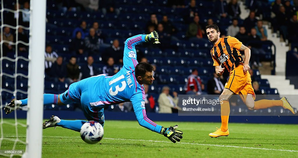 Robbie Brady of Hull City beats Boaz Myhill of West Bromwich Albion to score his teams second goal during the Capital One Cup Third Round match between West Bromwich Albion and Hull City at The Hawthorns on September 24, 2014 in West Bromwich, England.