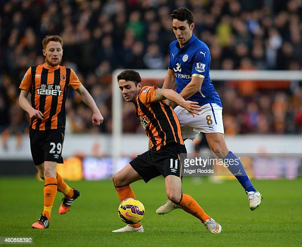 Robbie Brady of Hull City holds off Matthew James of Leicester City during the Barclays Premier League match between Hull City and Leicester City at...