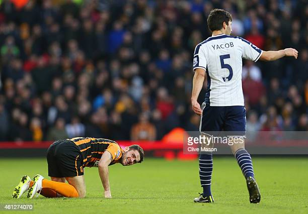 Robbie Brady of Hull City looks on after a challenge by Claudio Yacob of West Bromwich Albion during the Barclays Premier League match between West...