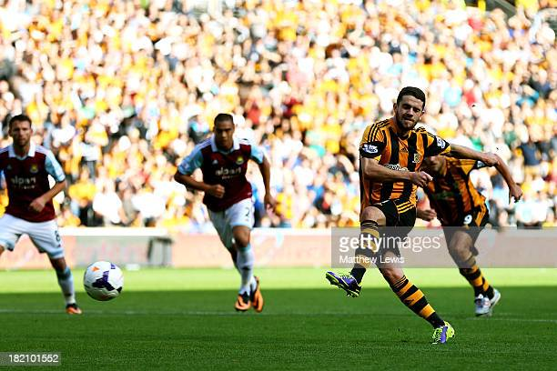 Robbie Brady of Hull City scores the opening goal from the penalty spot during the Barclays Premier League match between Hull City and West Ham...