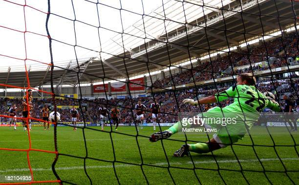 Robbie Brady of Hull City scores the opening goal from the penalty spot past goalkeeper Jussi Jaaskelainen of West Ham during the Barclays Premier...