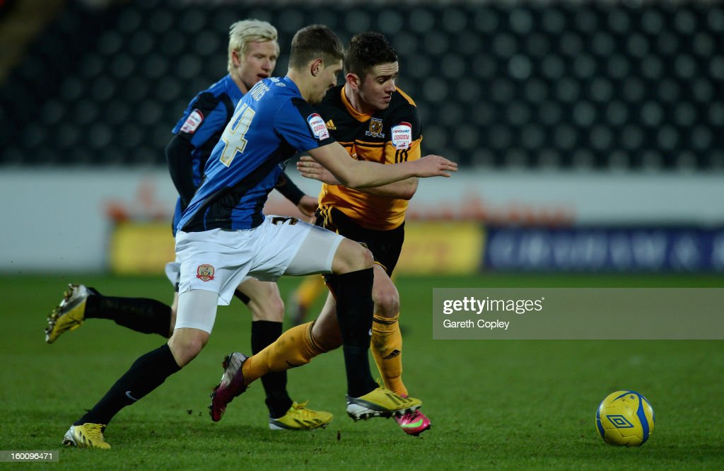 Robbie Brady of Hull gets past John Stones of Barnsley during the FA Cup Fourth Round between Hull City and Barnsley at KC Stadium on January 26, 2013 in Hull, England.