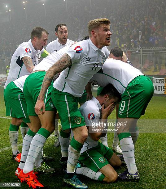 HERZEGOVINA NOVEMBER 13 Robbie Brady of Ireland celebrate scoring a goal with the team mates Daryl Murphy and James McClean during the EURO 2016...