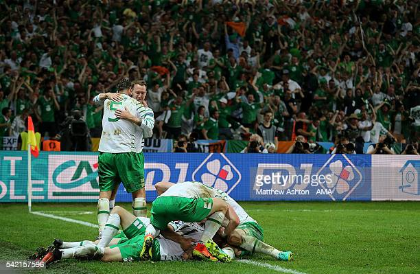 Robbie Brady of Ireland celebrates with his team-mates after scoring a goal to make the score 0-1 during the UEFA EURO 2016 Group E match between...