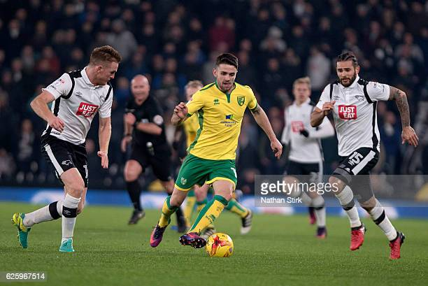 Robbie Brady of Norwich City and Alex Pearce and Bradley Johnson of Derby County in action during the Sky Bet Championship match between Derby County...