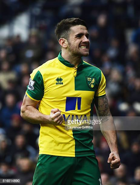 Robbie Brady of Norwich City celebrates scoring his team's first goal during the Barclays Premier League match between West Bromwich Albion and...