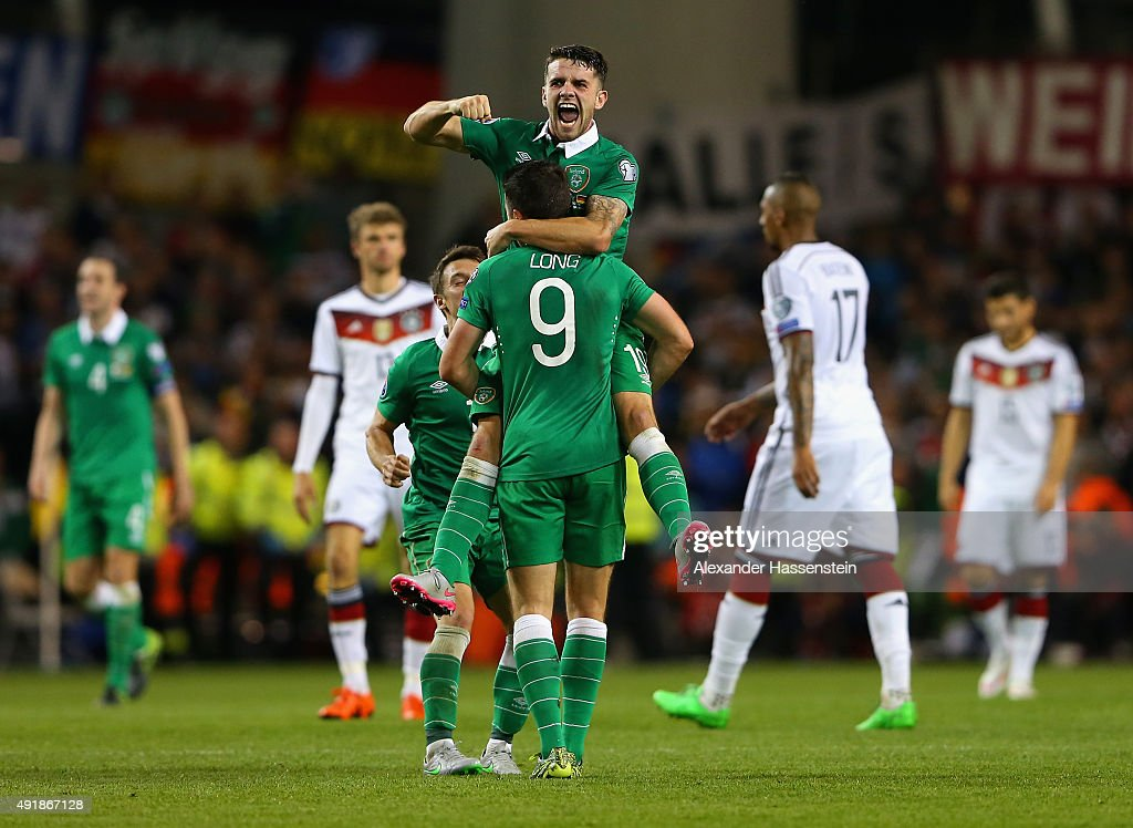 Robbie Brady of Republic of Ireland and Shane Long of Republic of Ireland celebrate victory after the UEFA EURO 2016 Qualifier group D match between Republic of Ireland and Germany at the Aviva Stadium on October 8, 2015 in Dublin, Ireland.