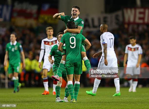Robbie Brady of Republic of Ireland and Shane Long of Republic of Ireland celebrate victory after the UEFA EURO 2016 Qualifier group D match between...
