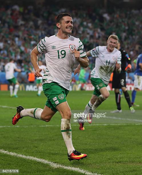 Robbie Brady of Republic of Ireland celebrates after he scores during the UEFA EURO 2016 Group E match between Italy and Republic of Ireland at Stade...