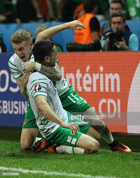 Robbie Brady of Republic of Ireland celebrates with James McClean of Republic of Ireland after he scores during the UEFA EURO 2016 Group E match...