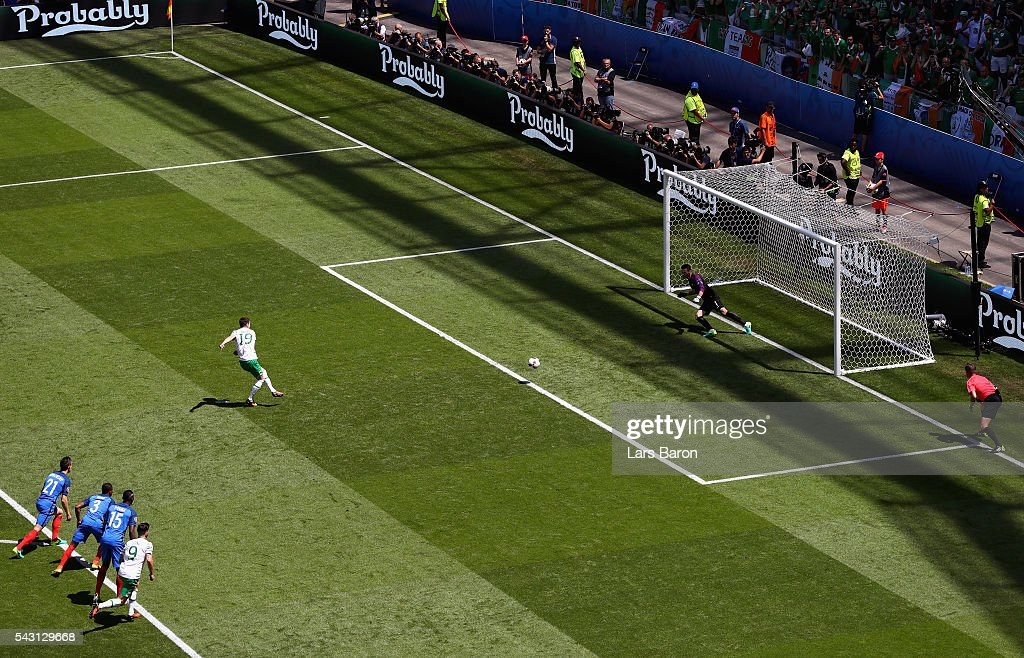 Robbie Brady (2nd R) of Republic of Ireland converts the penalty to score the opening goal past Hugo Lloris (1st R) of France during the UEFA EURO 2016 round of 16 match between France and Republic of Ireland at Stade des Lumieres on June 26, 2016 in Lyon, France.