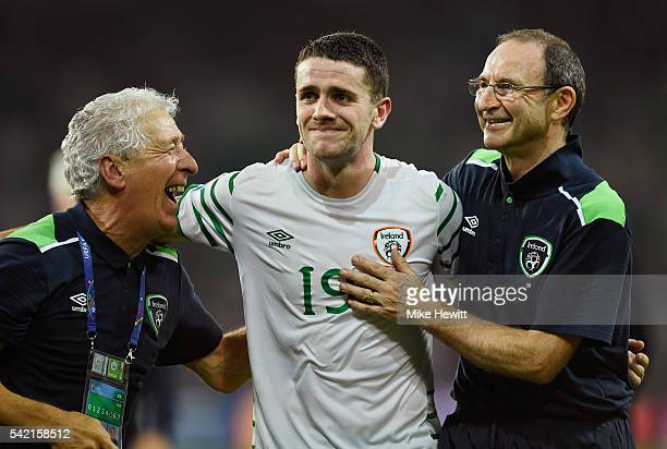 Robbie Brady of Republic of Ireland is congratulated by Martin O'Neill manager of Republic of Ireland after their team's 1-0 win in the UEFA EURO...