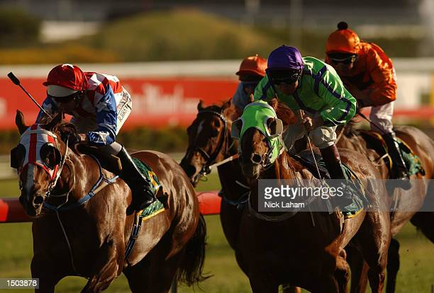 Robbie Brewer rides Top Slice alongside James Innes on National Saint in race 7 The City TattsLightning Handicap during the Spring Carnival meeting...