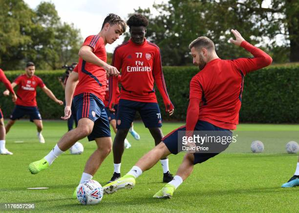 Robbie Burton Bukayo Saka and Shkodran Mustafi of Arsenal during the Arsenal Training Session at London Colney on September 23 2019 in St Albans...