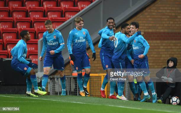 Robbie Burton celebrates scoring a goal for Arsenal with his team mates during the FA Youth Cup 4th Round match between Liverpool and Arsenal at...