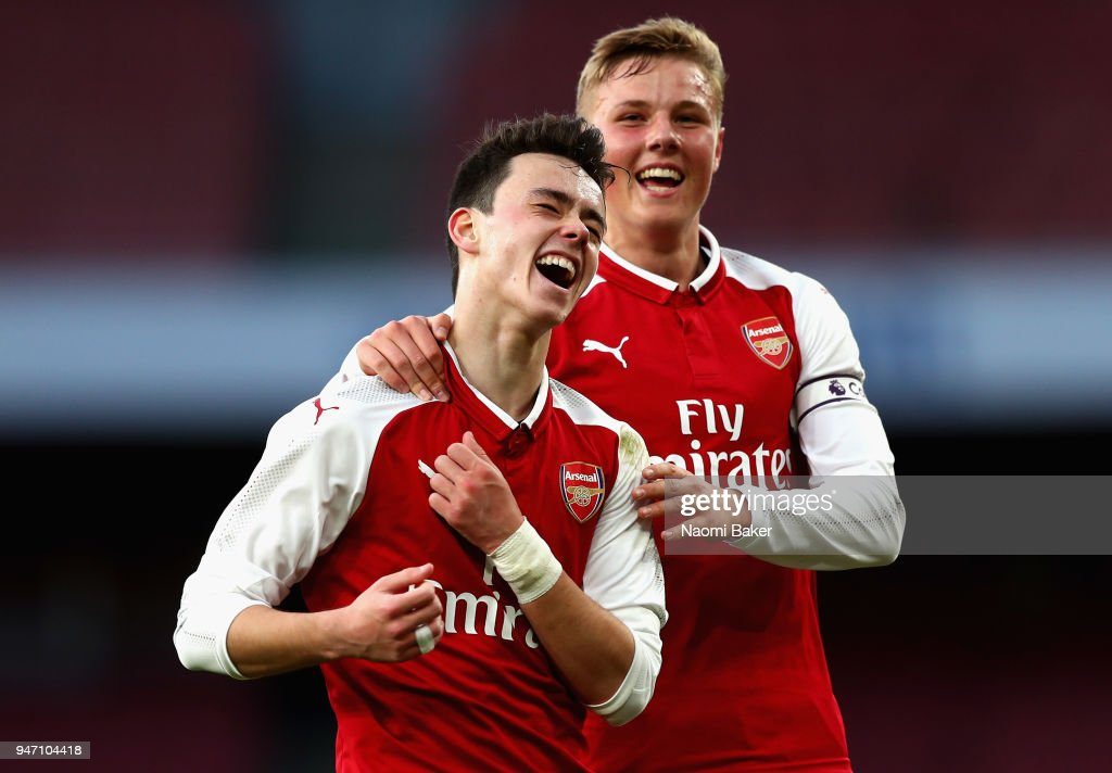Robbie Burton of Arsenal celebrates with Danny Bullard of Arsenal after he scores his sides third goal during the FA Youth Cup Semi Final 2nd Leg match between Arsenal and Blackpool at Emirates Stadium on April 16, 2018 in London, England.