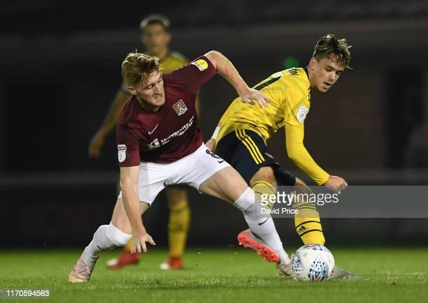 Robbie Burton of Arsenal challenges Ryan Watson of Northampton during the Leasingcom match between Northampton Town and Arsenal U21 at PTS Academy...