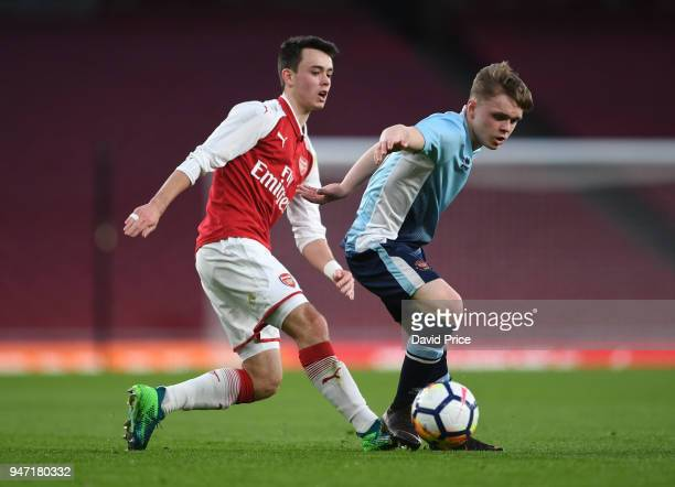 Robbie Burton of Arsenal closes down Finlay SinclairSmith of Blackpool during the match between Arsenal and Blackpool at Emirates Stadium on April 16...