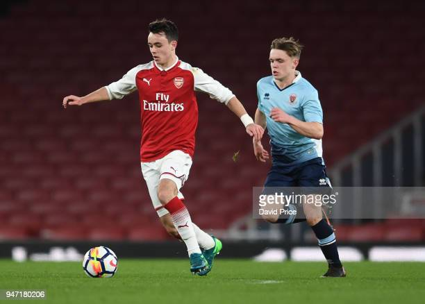 Robbie Burton of Arsenal takes on Finlay SinclairSmith of Blackpool during the match between Arsenal and Blackpool at Emirates Stadium on April 16...